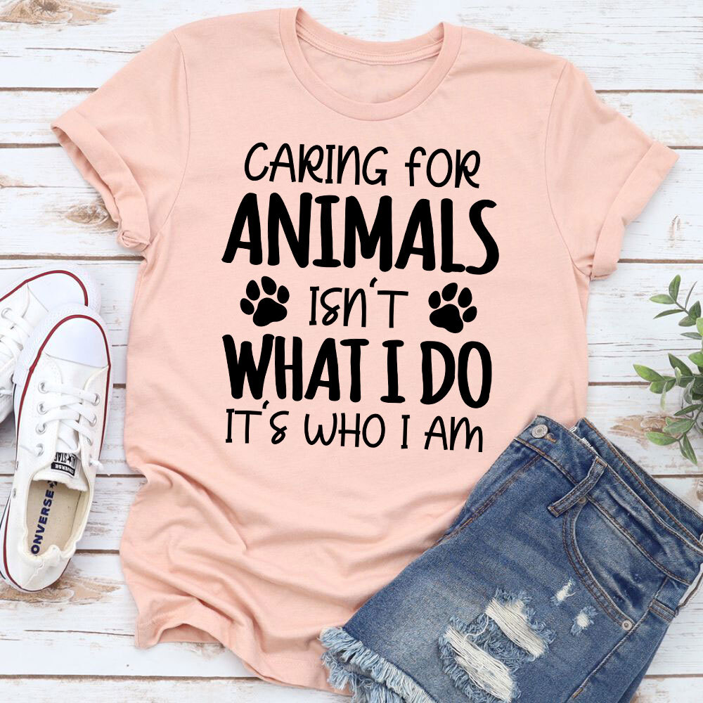 Caring For Animals Isn't What I Do It's Who I Am T-Shirt (Heather Prism Peach / 2Xl)